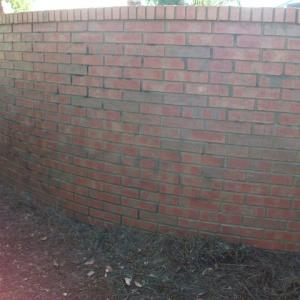Graffiti Removal on community brick wall